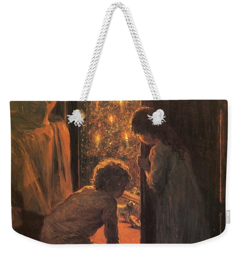 The Christmas Tree Weekender Tote Bag featuring the painting The Christmas Tree by Henry Mosler