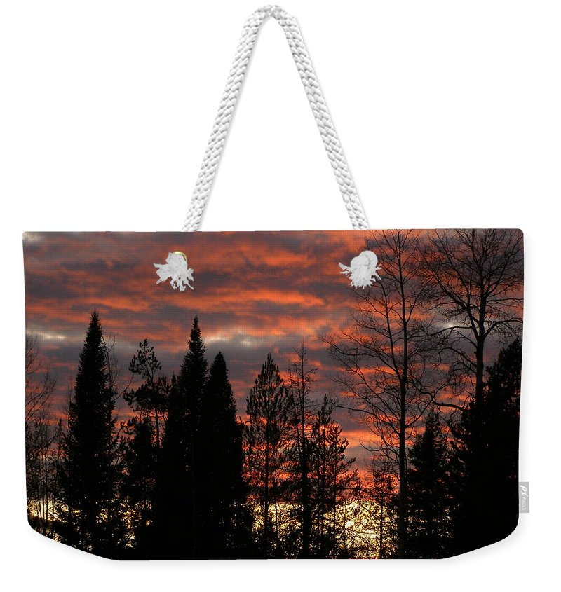 Sunset Weekender Tote Bag featuring the photograph The Close Of Day by DeeLon Merritt
