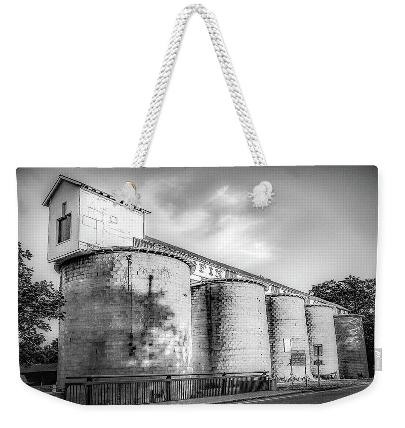 Weekender Tote Bag featuring the photograph The Coal Silos by Kendall McKernon