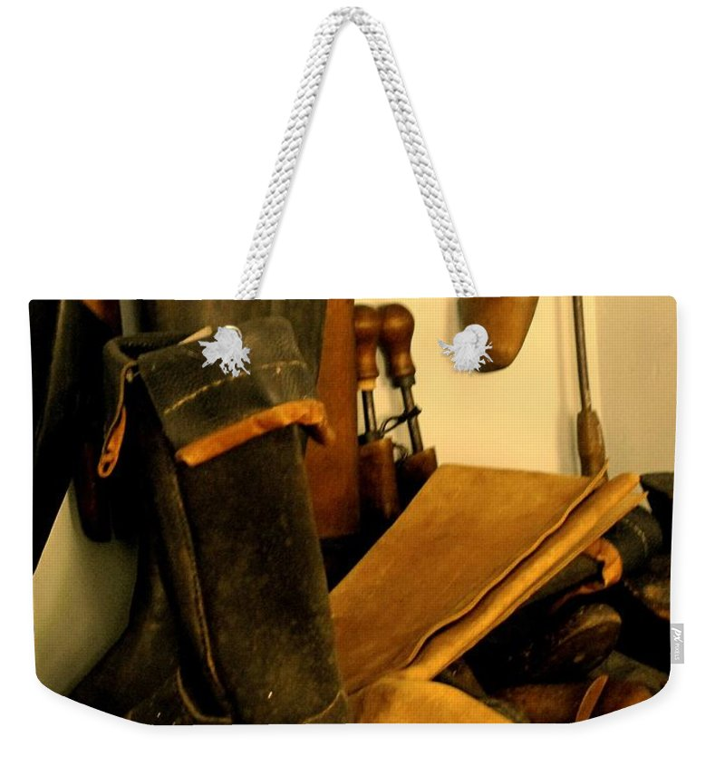 Shoess Weekender Tote Bag featuring the photograph The Cobbler by Ian MacDonald