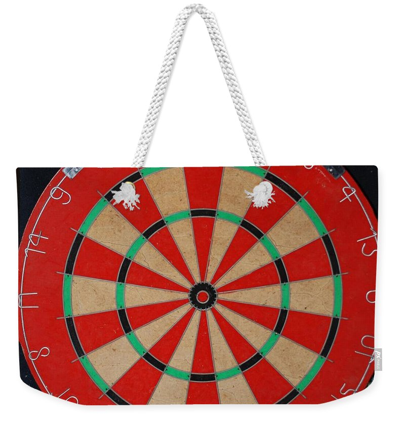 Macro Weekender Tote Bag featuring the photograph The Dart Board by Rob Hans