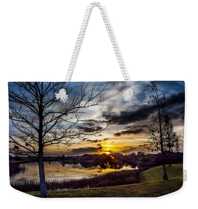 Sunrise Weekender Tote Bag featuring the photograph The Dawn Awakens by Norman Johnson