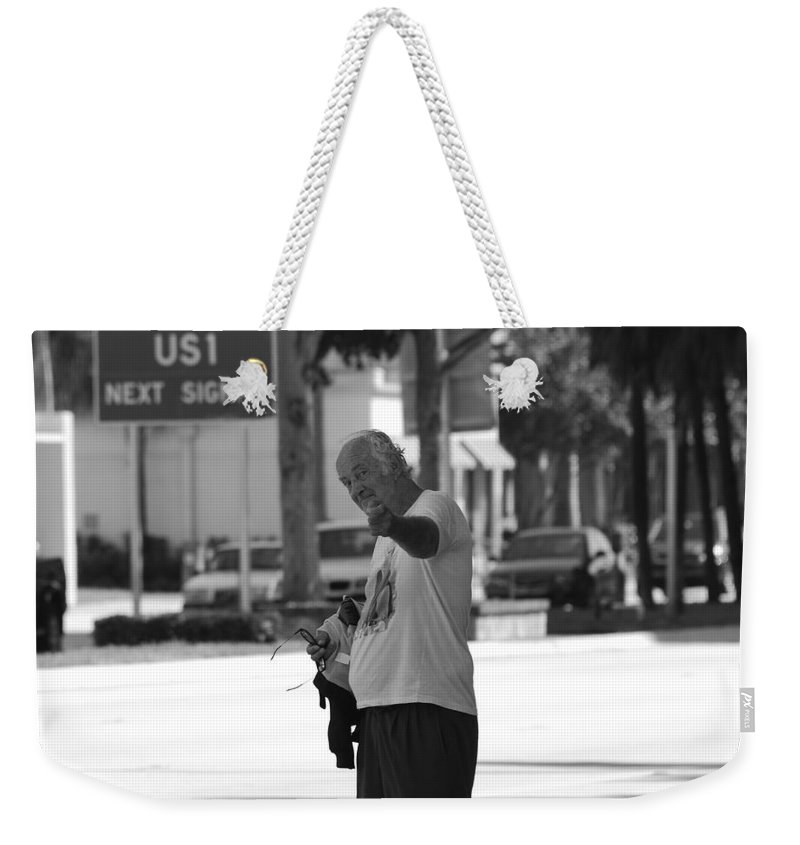 Black And White Weekender Tote Bag featuring the photograph The Devil Man by Rob Hans