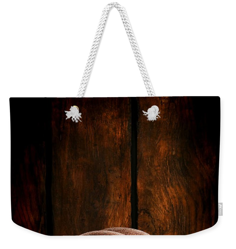 Cowboy Hat Weekender Tote Bag featuring the photograph The Dirty Brown Hat by Olivier Le Queinec