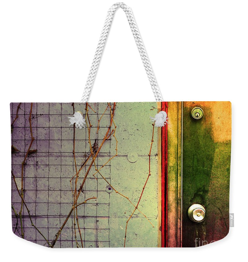 Weeds Weekender Tote Bag featuring the photograph The Door The Wall And The Weeds by Tara Turner