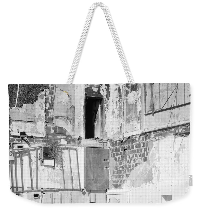 Architecture Weekender Tote Bag featuring the photograph The Doorway To Darkness by Rob Hans