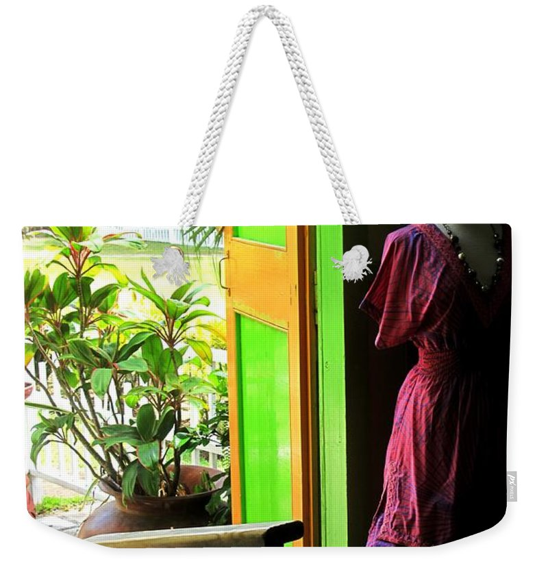 Dress Weekender Tote Bag featuring the photograph The Dress Store by Ian MacDonald