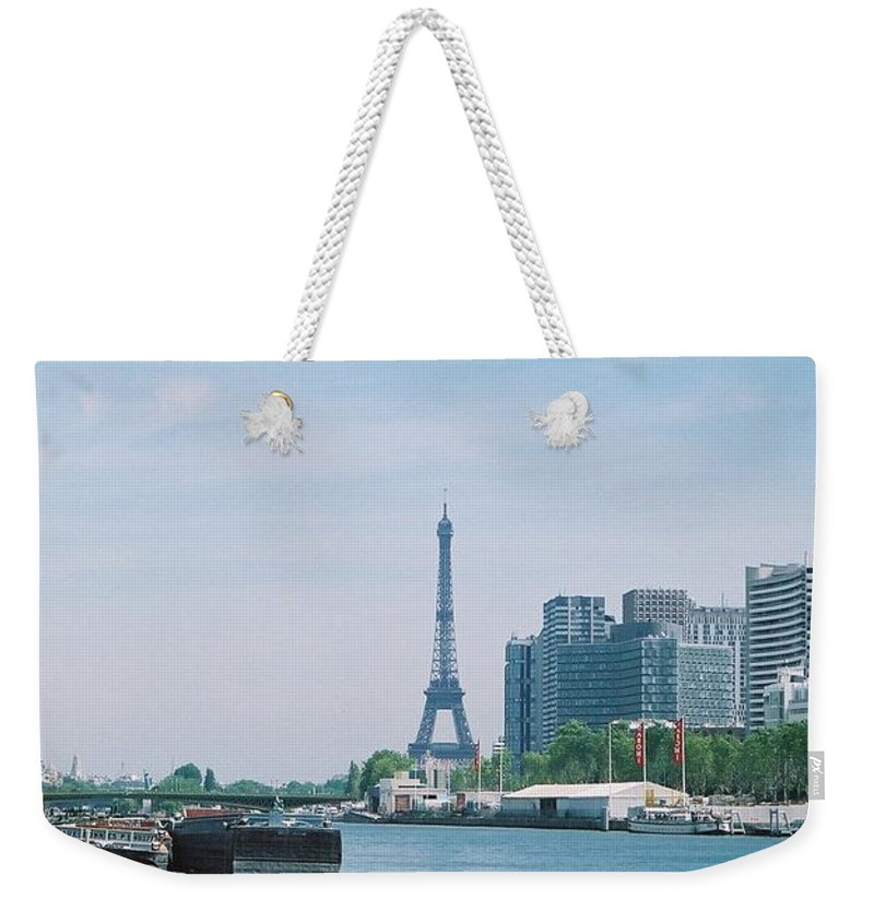 The Eiffel Tower Weekender Tote Bag featuring the photograph The Eiffel Tower And The Seine River by Nadine Rippelmeyer