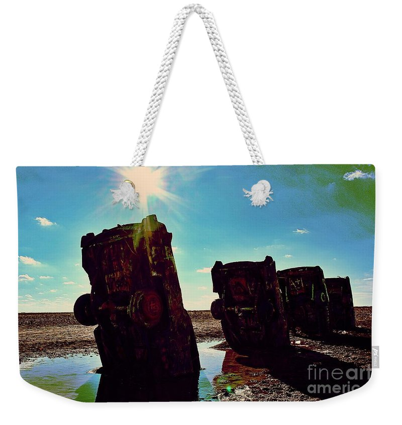 Cadillac Ranch Weekender Tote Bag featuring the photograph The Ever-rising Flood Of Philistinism by Jenny Revitz Soper