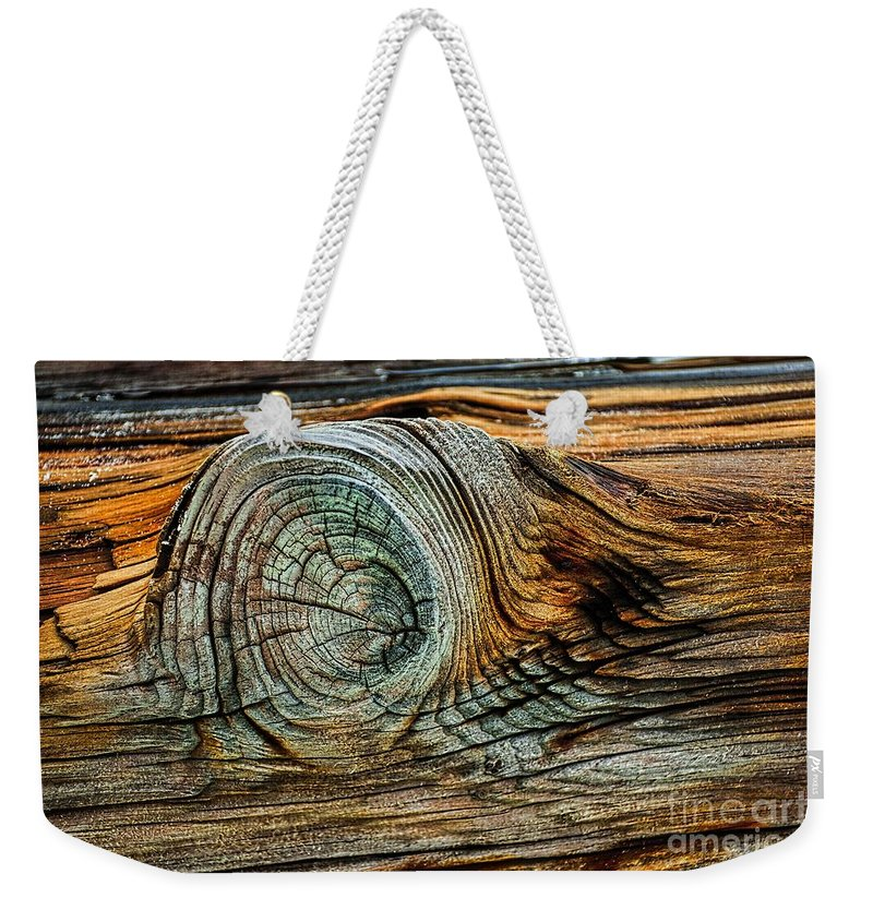 21st Century Weekender Tote Bag featuring the photograph The Eye In The Wood by Norman Gabitzsch