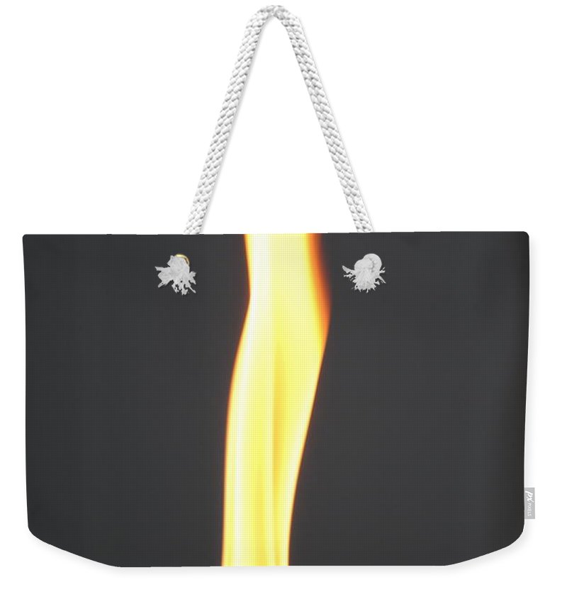 Flame Weekender Tote Bag featuring the photograph The Flame by Jost Houk
