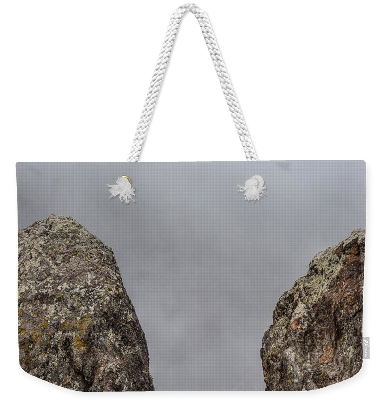 Fog Weekender Tote Bag featuring the photograph The Fog Through The Rocks by Michael Putthoff