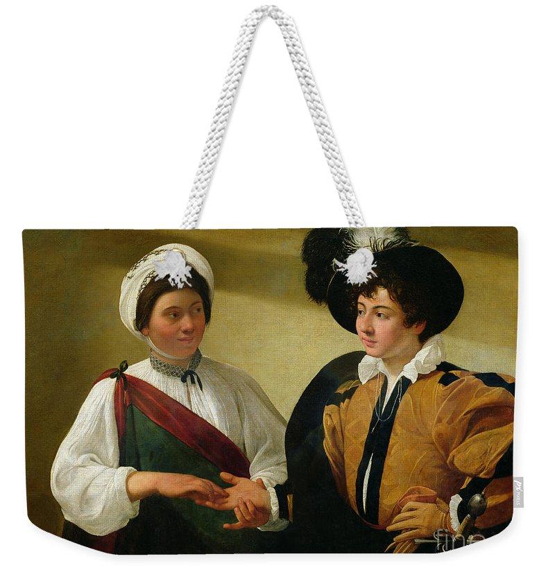 The Fortune Teller Weekender Tote Bag featuring the painting The Fortune Teller by Michelangelo Merisi da Caravaggio