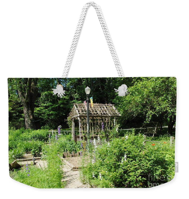 Floral Weekender Tote Bag featuring the photograph The Garden by Jost Houk