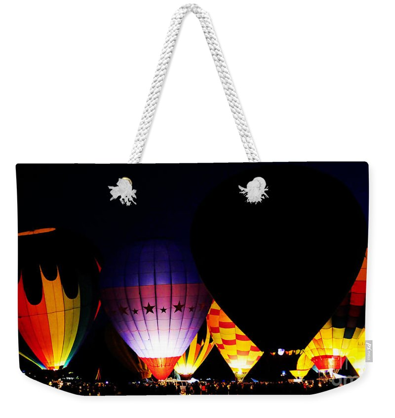 Clay Weekender Tote Bag featuring the photograph The Glowing by Clayton Bruster