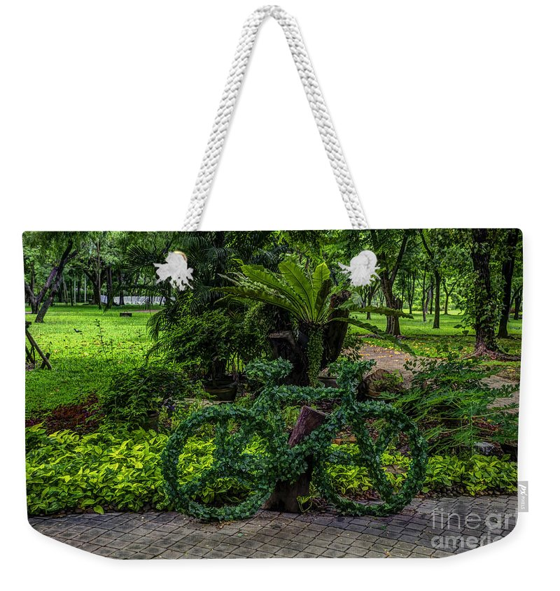 Michelle Meenawong Weekender Tote Bag featuring the photograph The Green Bicycle by Michelle Meenawong