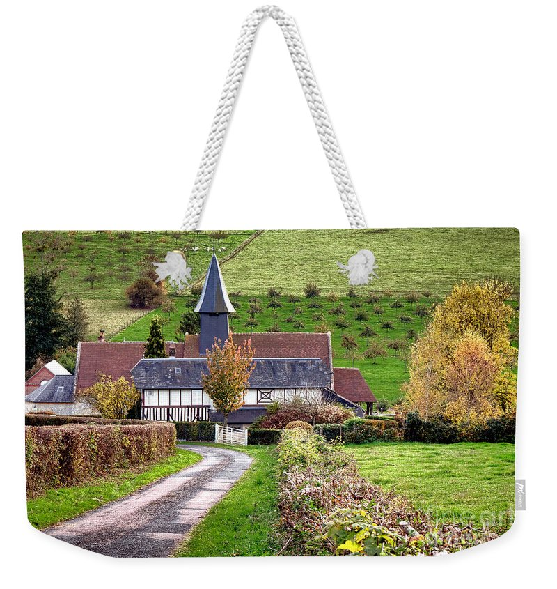 Normandy Weekender Tote Bag featuring the photograph The Heart Of Normandy by Olivier Le Queinec