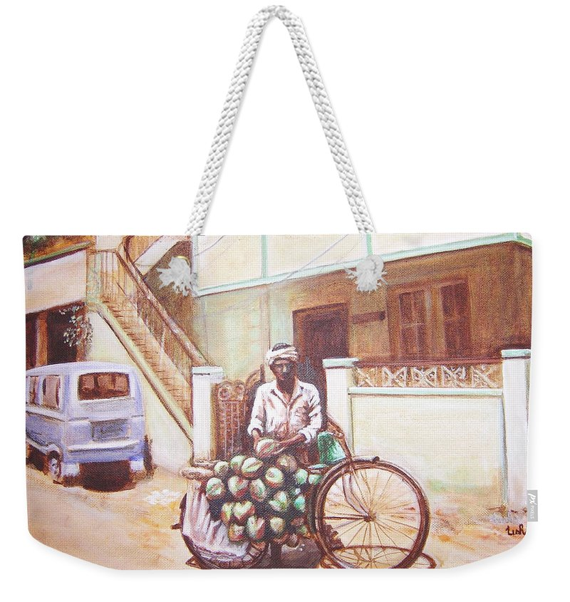 Usha Weekender Tote Bag featuring the painting The Indian Tendor-coconut Vendor by Usha Shantharam