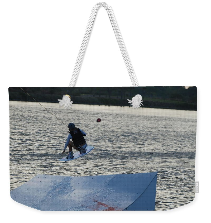 Water Weekender Tote Bag featuring the photograph The Jump by Rob Hans