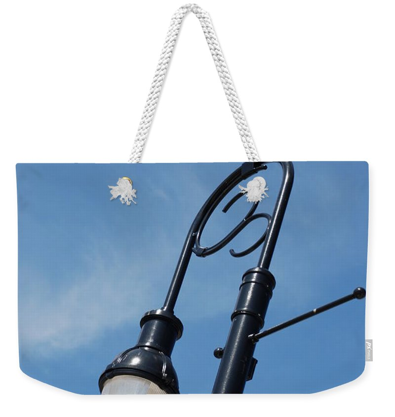 Blue Sky Weekender Tote Bag featuring the photograph The Lamp Post by Rob Hans