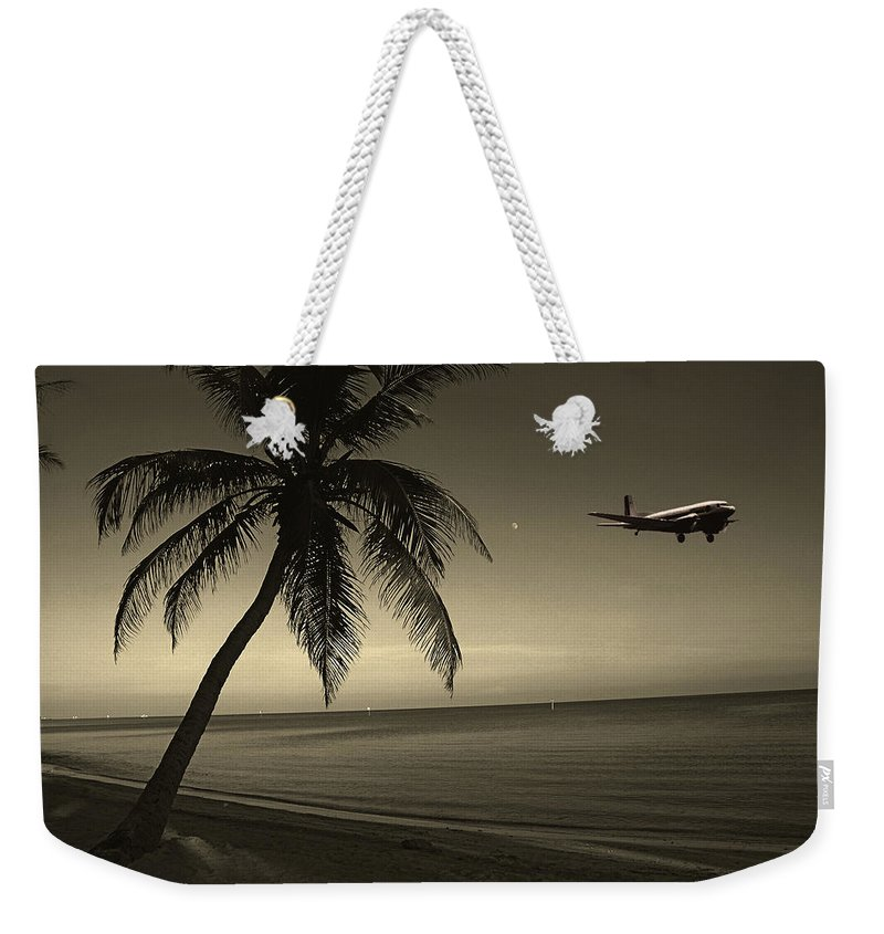 Palm Weekender Tote Bag featuring the photograph The Last Flight Out by Susanne Van Hulst