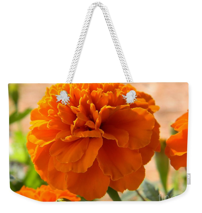 Flower Weekender Tote Bag featuring the photograph The Last Marigold by Leslie Revels