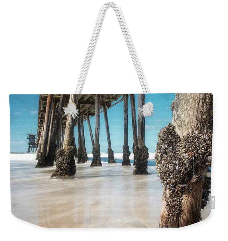 Barnacle Weekender Tote Bag featuring the photograph The Life Of A Barnacle by Ryan Manuel