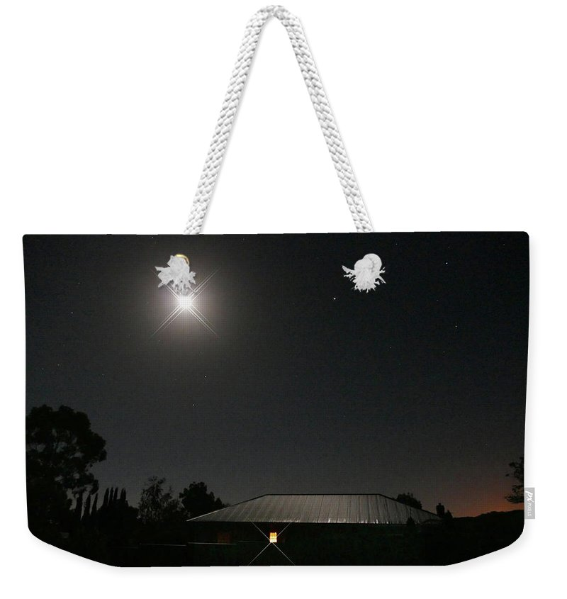 Light Weekender Tote Bag featuring the photograph The Light Has Come by Evelyn Tambour