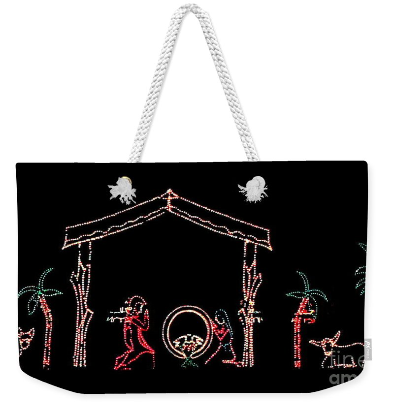 Christmas Weekender Tote Bag featuring the photograph The Light Of Christmas by Myrna Bradshaw