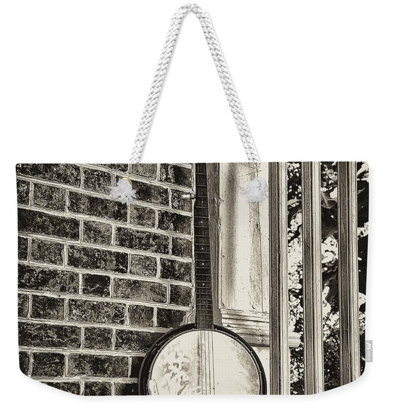 Banjo Weekender Tote Bag featuring the photograph The Lonely Banjo by Bill Cannon