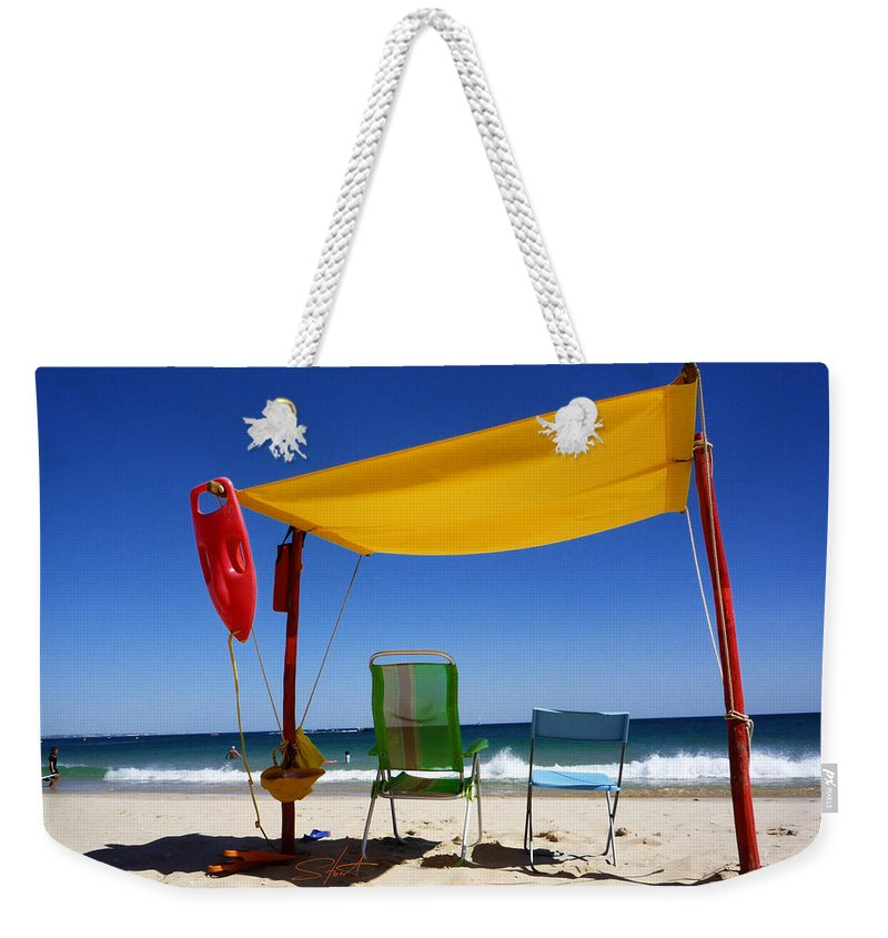 Life Guard Weekender Tote Bag featuring the photograph The Lonely Sea And The Sky by Charles Stuart