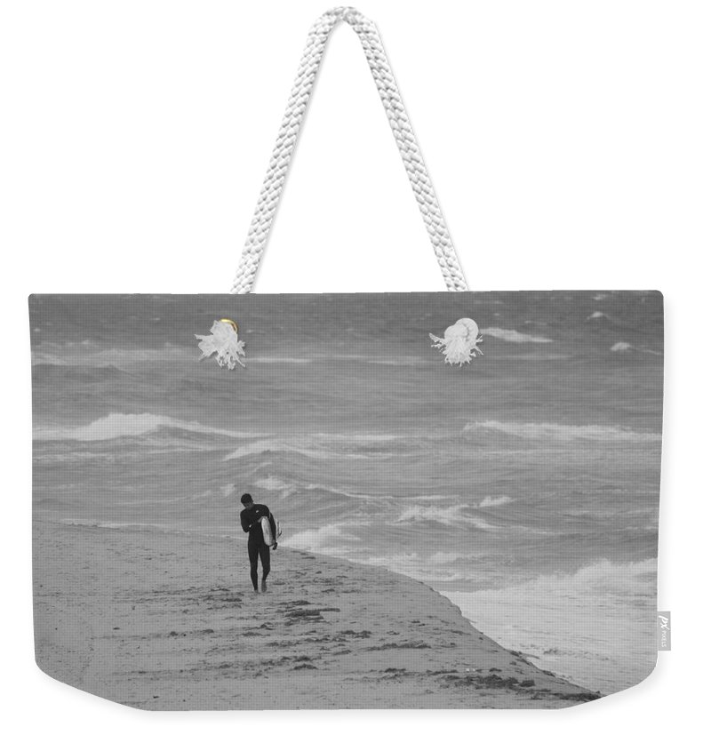 Black And White Weekender Tote Bag featuring the photograph The Lonely Surfer Dude by Rob Hans