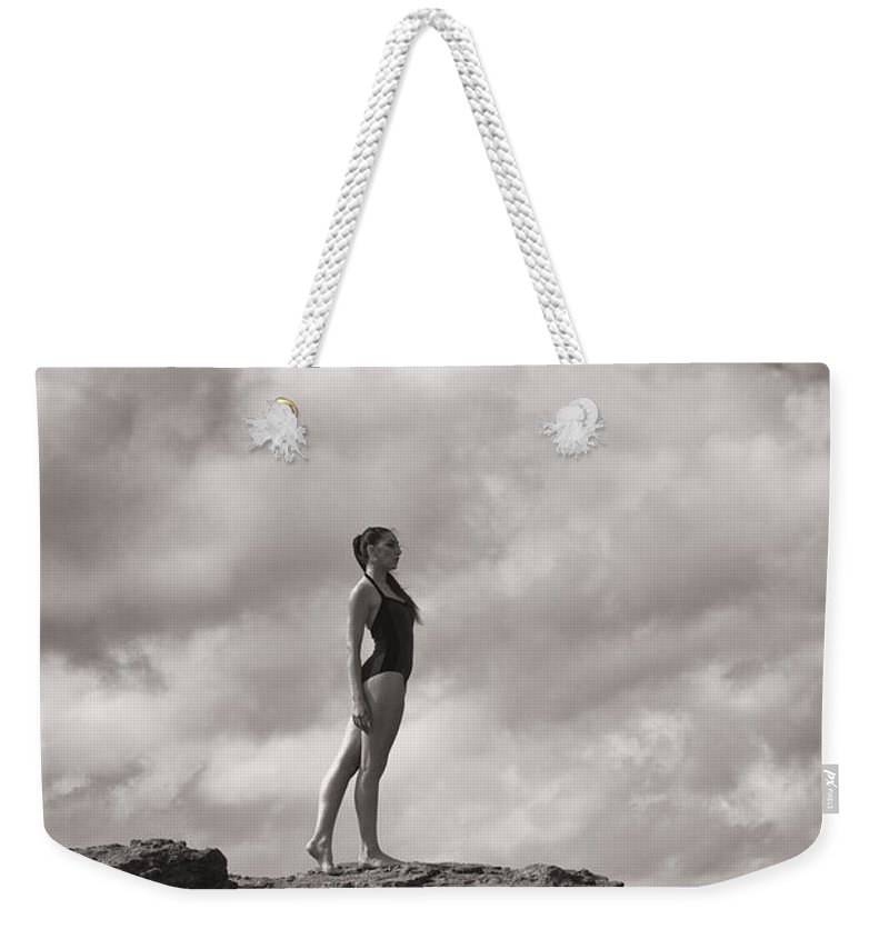Girl Weekender Tote Bag featuring the photograph The Long Distance Swimmer by Clayton Bastiani