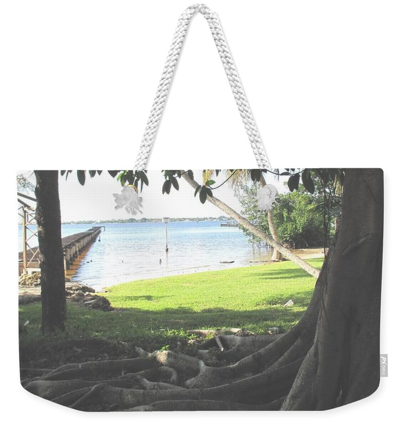 Florida Weekender Tote Bag featuring the photograph The Long Dock by Ian MacDonald