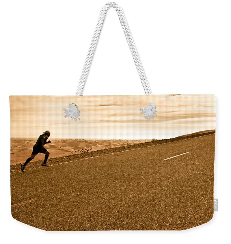 Run Weekender Tote Bag featuring the photograph The Long Road by Scott Sawyer