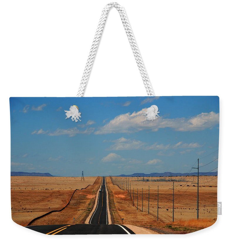 Long Road Weekender Tote Bag featuring the photograph The Long Road To Santa Fe by Susanne Van Hulst
