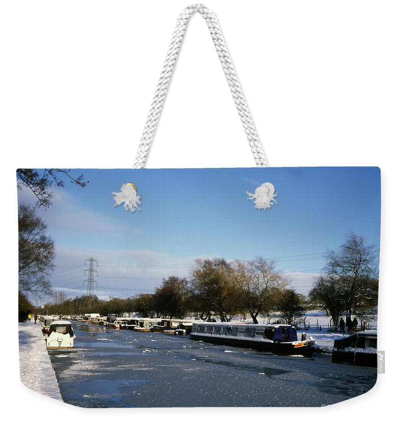 [macclesfield Canal] Poynton Cheshire England Romantic Rural [tranquil Scene] Canal [canal Boat] [inland Waterway] [narrow Boat] Navigate Sailing Steering [united Kingdom] Romance Rustic Tranquil [great Britain] Horizontal Landscape Country Serenity [tranquil Scenes] Boat Cheshire Winter Snow Frozen Cold Snow English British Photo Photos Photograph Photographs Photography Weekender Tote Bag featuring the photograph The Macclesfield Canal At Poynton In Winter And Frozen Cheshire England by Michael Walters