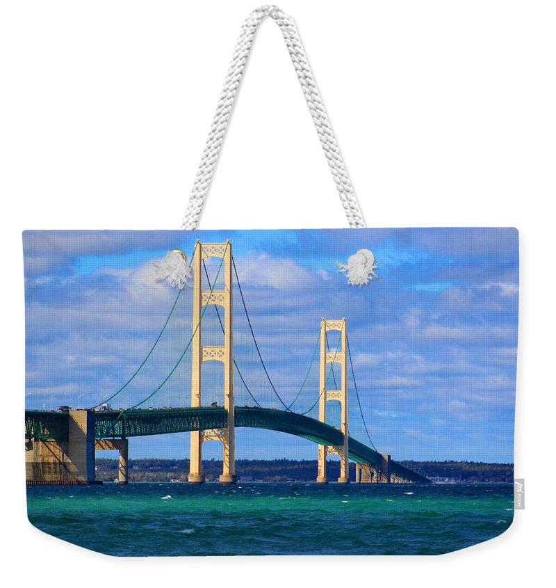 The Mackinac Bridge Weekender Tote Bag featuring the photograph The Mackinac Bridge by Michael Rucker