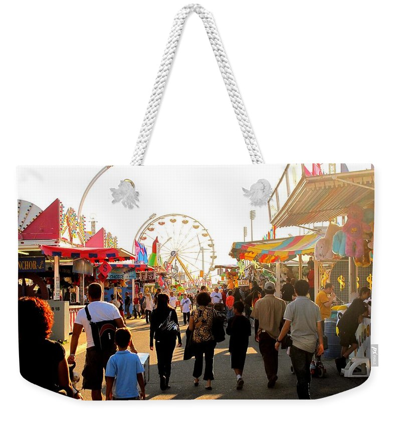 Canadian Weekender Tote Bag featuring the photograph The Midway Stroll by Ian MacDonald