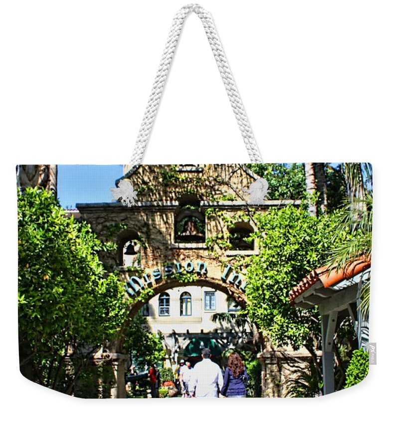 Mission Inn Weekender Tote Bag featuring the photograph The Mission Inn Stage Coach Entrance by Tommy Anderson