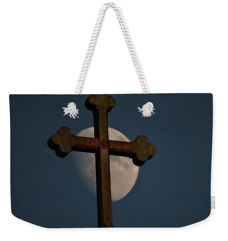 Moon Weekender Tote Bag featuring the photograph The Moon And The Cross by Explorer Lenses Photography