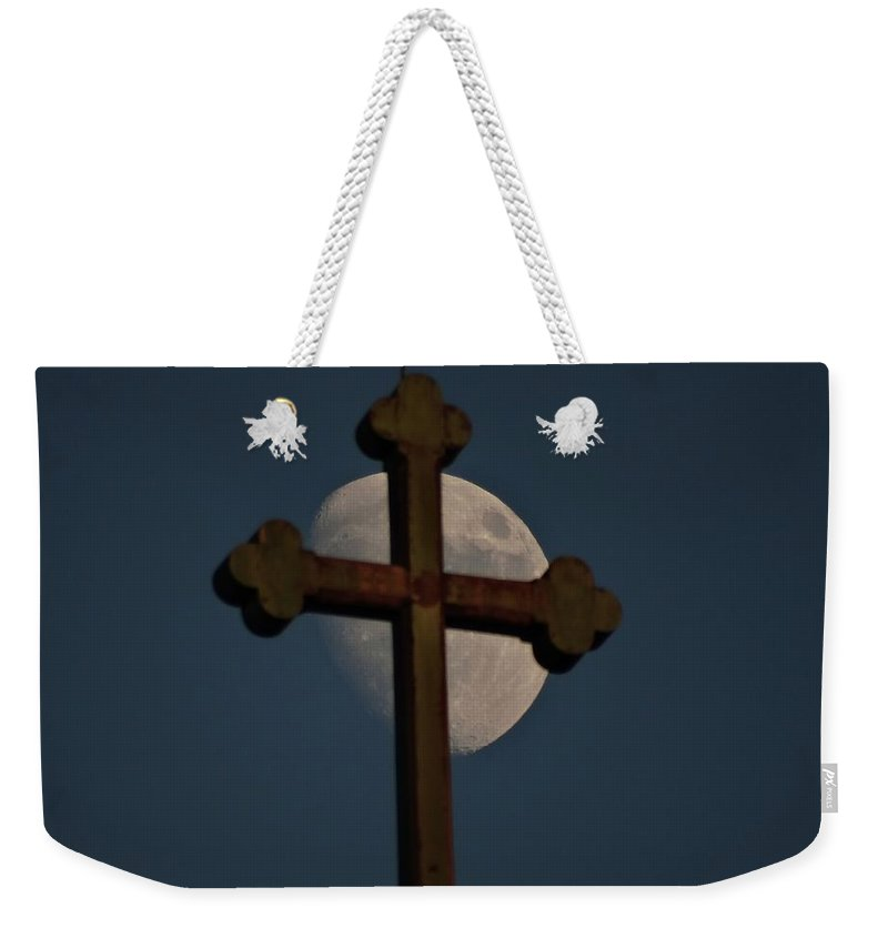 Moon Weekender Tote Bag featuring the photograph The Moon And The Cross IIi. by Explorer Lenses Photography