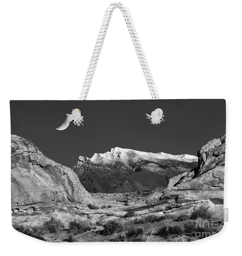 Moon Weekender Tote Bag featuring the photograph The Moon And The Mountain Range by Mike Nellums