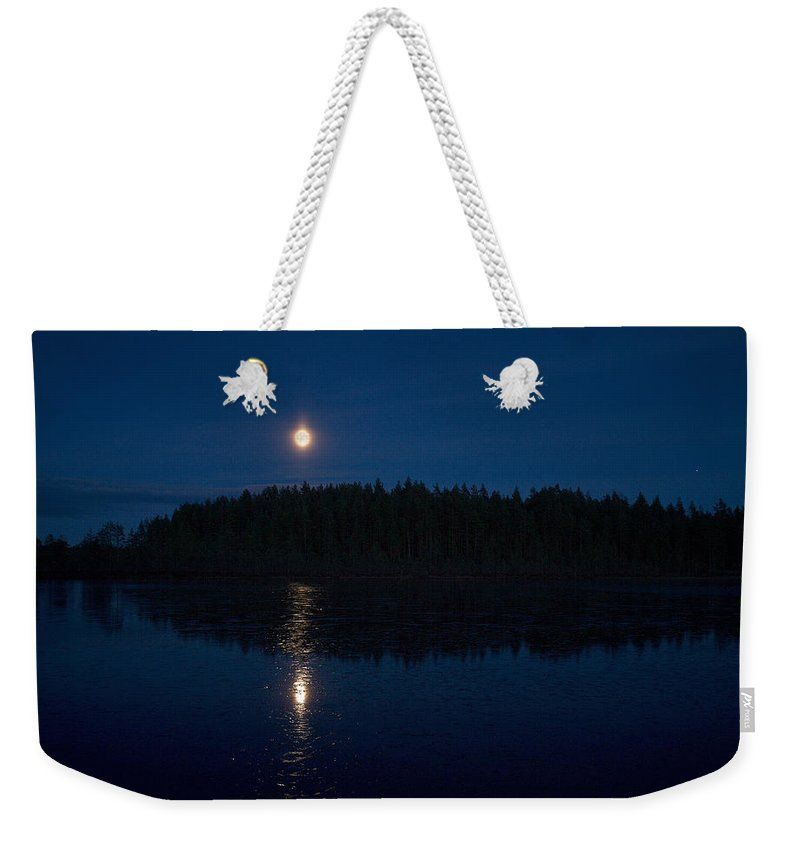 Lehtokukka Weekender Tote Bag featuring the photograph The Moon Over Saari-soljanen by Jouko Lehto