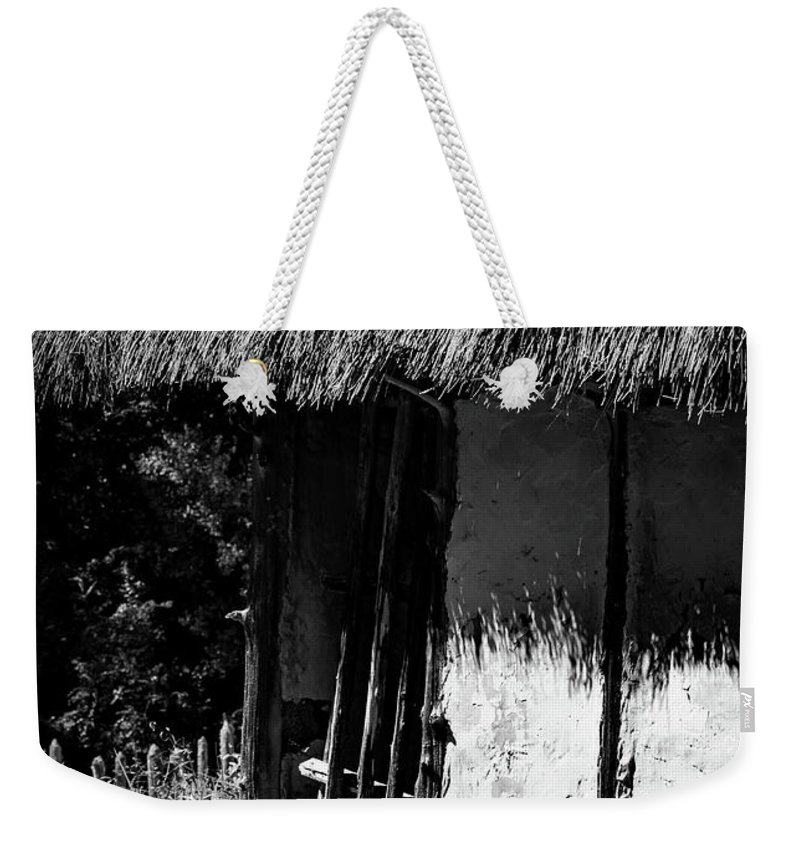 Indian Weekender Tote Bag featuring the photograph The Mound Door by Megan Thompson