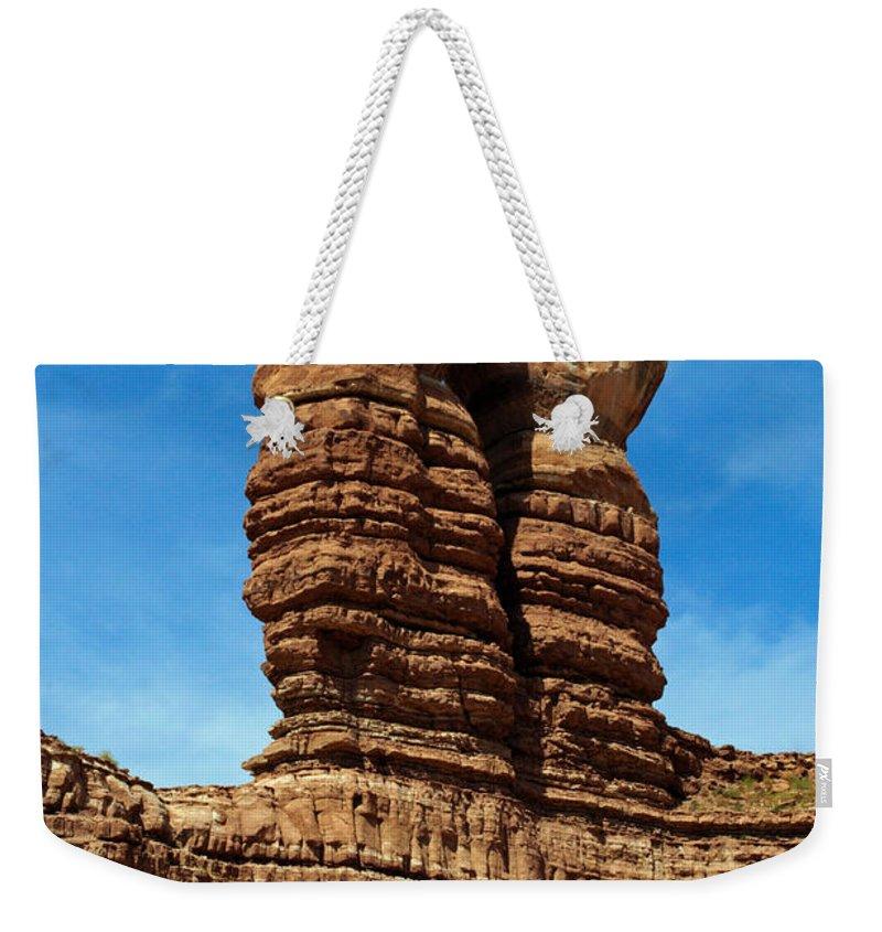 The Navajo Twin Rocks Weekender Tote Bag featuring the photograph The Navajo Twin Rocks by Tikvah's Hope