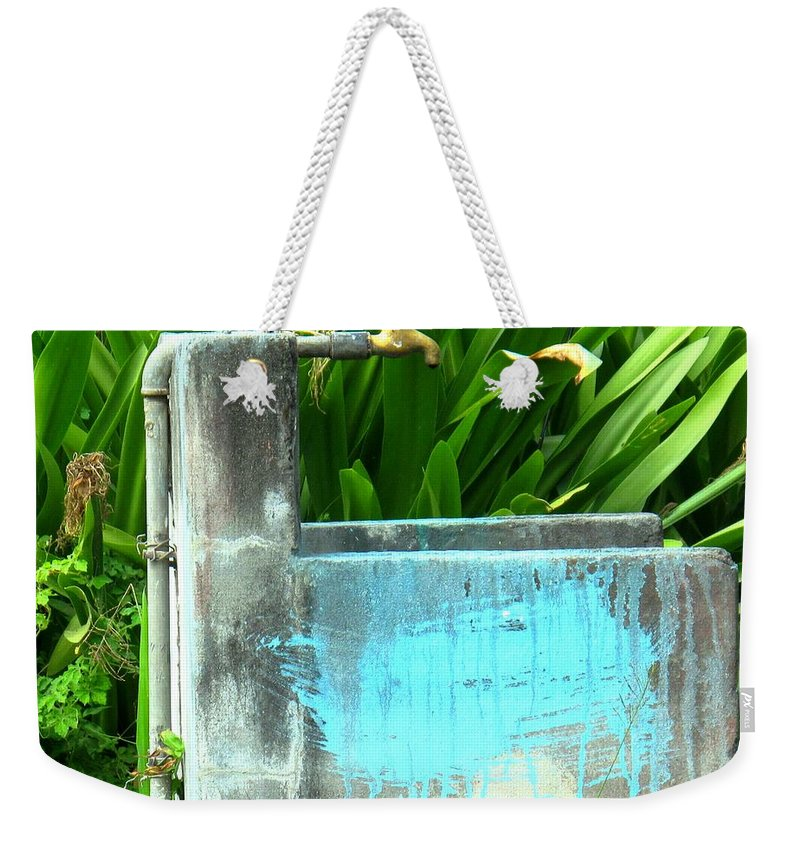 Water Weekender Tote Bag featuring the photograph The Neighborhood Water Pipe by Ian MacDonald