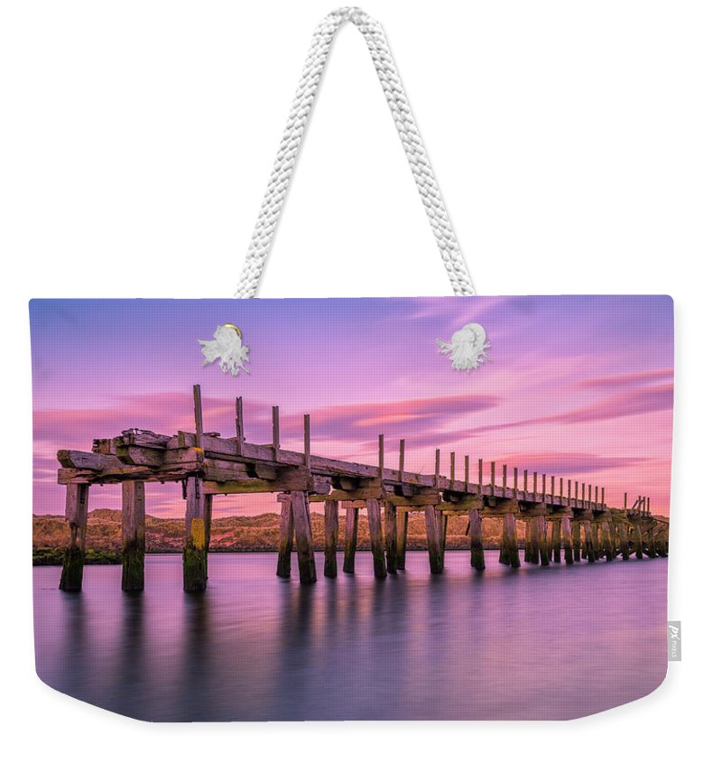 Old Bridge Weekender Tote Bag featuring the photograph The Old Bridge at Sunset by Roy McPeak
