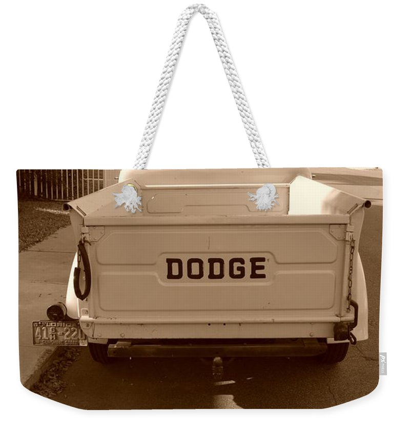 Sepia Weekender Tote Bag featuring the photograph The Old Dodge by Rob Hans