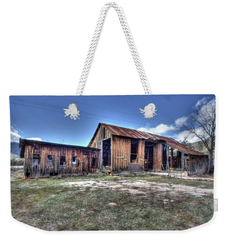 Abandoned Decayed Deteriorated Rotten Aged Old Structure Building Barn Wood Charming Character Landscape Beauty Color Red Green Blue Sky Clouds Hdr Pine Northern Arizona Weekender Tote Bag featuring the photograph The Old Haunted Barn by Thomas Todd